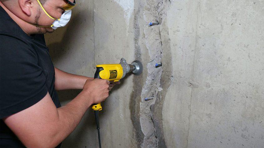 basement wall crack prep work with grinder